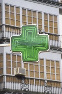 A European pharmacy sign. Image by Neil Lukas (c) Dorling Kindersley